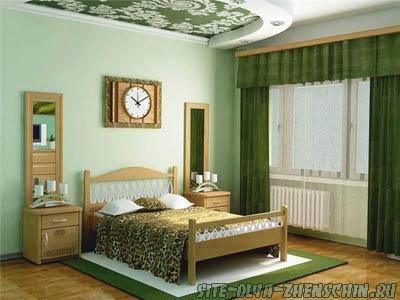 Интерьер спальни в зеленоватых тонах.