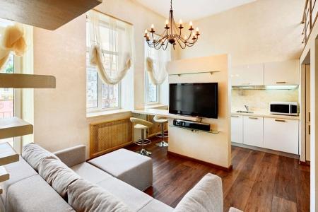 Интерьер гостиной с выделением зоны отдыха